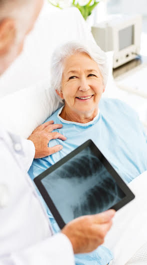 Older woman getting an chest x-ray
