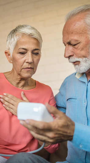 Older couple checking their blood pressure